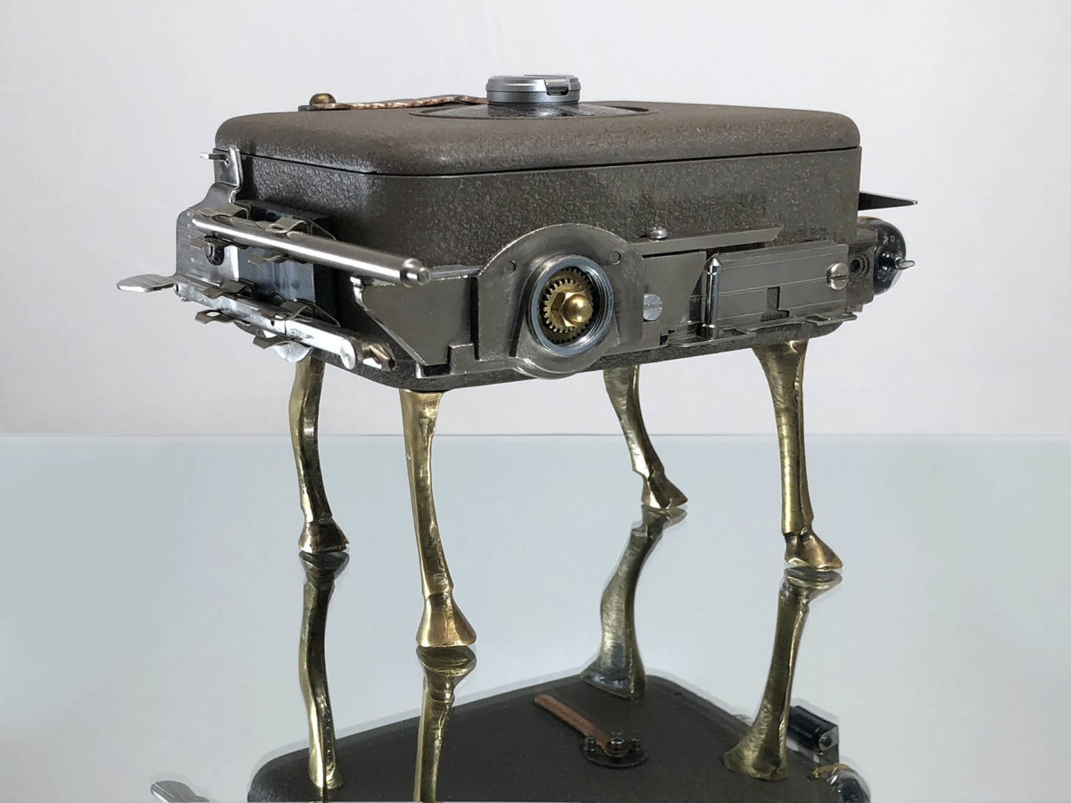 video camera box sculpture with camel legs