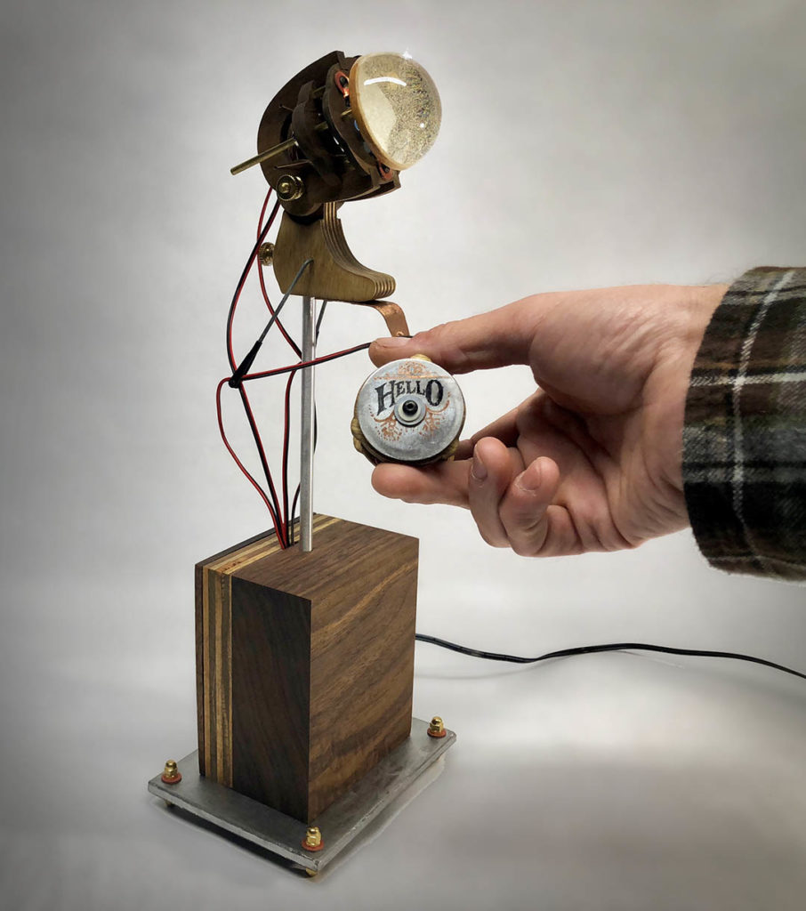 interactive kinetic sculpture with moving eye by lex talkington